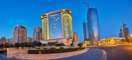BAKU, AZERBAIJAN - OCTOBER 9, 2017: Panorama of hotel complexes of Baku neighbors with coastal promenade of the city, on October 9 in Baku
