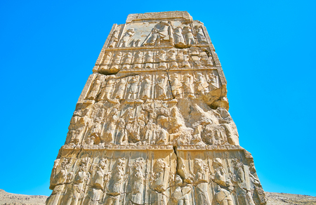 The wall of the ancient gate with preserved reliefs, Persepolis archaeological site, Iran.