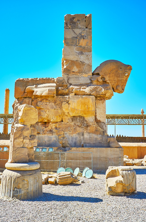 The ruins of the ancient gate with horse protome at the entrance to Hundred Columns Hall, Persepolis, Iran.