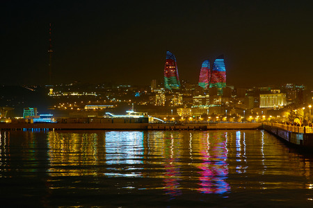 Beautiful night cityscape of Baku with bright Flame Towers with defferent lights, Azerbaijan