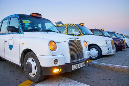 BINA, AZERBAIJAN - OCTOBER 9, 2017: Transfer from Heydar Aliyev Airport to Baku on white cab is the first pleasure meeting with Azerbaijan, on October 9 in Bina
