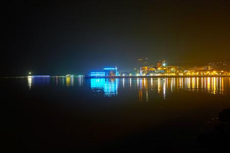 Beautiful illumination of buildings located on coastline of Caspian Sea in Baku, Azerbaijan