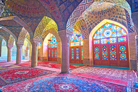 SHIRAZ, IRAN - OCTOBER 12, 2017: The prayer hall of Nasir Ol-Molk mosque is the best place to enjoy the islamic architecture of Shiraz and complex tiled decoration, on October 12 in Shiraz.