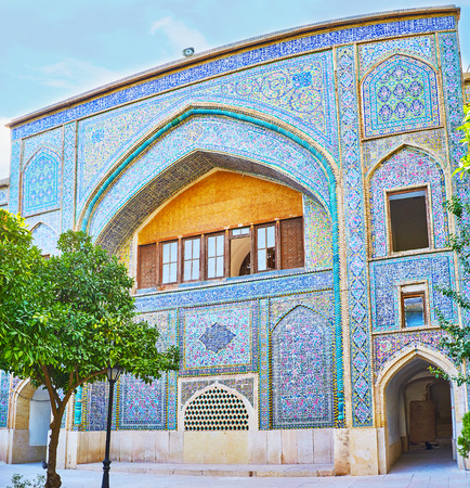 The colored tiled portal (iwan) of Madraseh-ye Khan, the medieval theological college in Shiraz, Iran. Editorial