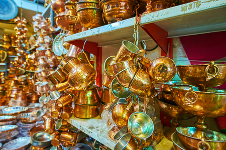 The market stall of Ordu Bazaar offers beautiful handmade copper tea sets, decorated with chasing, Shiraz, Iran.
