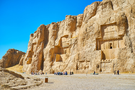 NAQSH-E RUSTAM, IRAN - OCTOBER 13, 2017: Naqsh-e Rustam Necropolis is the notable architectural ensemble of the ancent tombs, cut in rocky cliff, on October 13 in Naqsh-e Rustam.