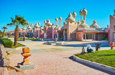 One of the central streets of resort with numerous pavilions of Alf leila wa leila (1001 nights) market, built in Arabic style with carved domes and slender towers, Sharm El Sheikh, Egypt.
