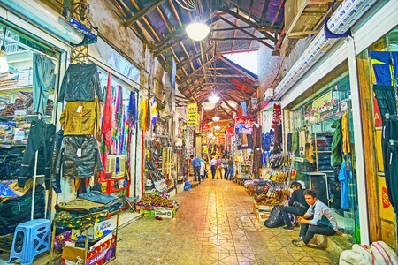 SHIRAZ, IRAN - OCTOBER 12, 2017: Historic Mesgarha Bazaar is the perfect place for the tourist shopping, here visitors enjoy local goods, Persian trade traditions and unique atmosphere, on October 12 in Shiraz.