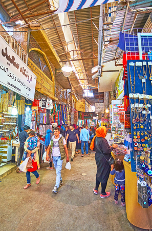 SHIRAZ, IRAN - OCTOBER 12, 2017: The crowded alley of Vakil Bazaar, the popular shopping area among the locals and tourists, on October 12 in Shiraz.