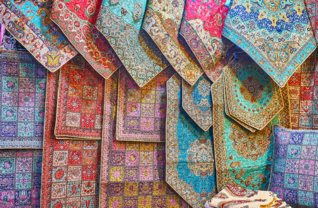 The showcase of Vakil Bazaar store with wide range of silk tapestries with complex Persian patterns, Shiraz, Iran.