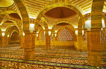 SHARM EL SHEIKH, EGYPT- DECEMBER 15, 2017: The arches in prayer hall of modern Al Sahaba mosque, columns are decorated with carved inscriptions, on December 15 in Sharm El Sheikh.