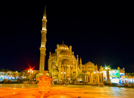 The evening town is the perfect place for romantic walk, bright lights make it even more beautiful, Al Sahaba mosque looks like the fairy tale castle, Sharm El Sheikh, Egypt. Stock Photo