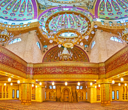 SHARM EL SHEIKH, EGYPT- DECEMBER 15, 2017: Panorama of upper prayer hall of Sahaba mosque with multiple painted domes, inscriptions from Quran and fine golden patterns, on December 15 in Sharm El Sheikh.