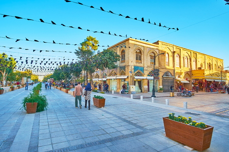SHIRAZ, IRAN - OCTOBER 12, 2017: Panorama of Zand walk street with traditional edifices, flowers in pots, souvenir stores and cafes, on October 12 in Shiraz.