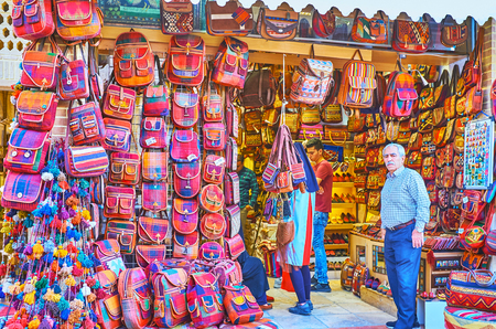SHIRAZ, IRAN - OCTOBER 12, 2017: The large amount of bags in ethnic style, produced from the woven material and leather, on October 12 in Shiraz.