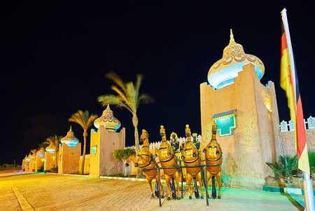 The ramparts with towers and nice domes  of Fantasia palace - modern entertainment center built in medieval Arabic style, Sharm El Sheikh, Egypt.