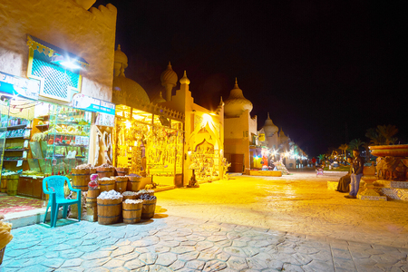 SHARM EL SHEIKH, EGYPT- DECEMBER 15, 2017: The alley of 1001 nights market stretches along the interesting stalls, offering spices, souvenirs, handicrafts and other tourist goods, on December 15 in Sharm El Sheikh. Editorial