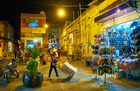 SHIRAZ, IRAN - OCTOBER 12, 2017: The walk in the evening Bazar-e No with numerous stalls and street vendors, on October 12 in Shiraz.