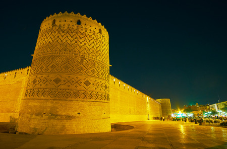 The leaning tower of old Arg Karim Khan (citadel) is decorated with geometric patterns, Shiraz, Iran.