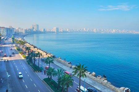 ALEXANDRIA, EGYPT - DECEMBER 18, 2017: The heavy traffic along the Corniche embankment, the buildings of city center are seen through the morning haze, on December 18 in Alexandria.