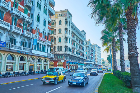 ALEXANDRIA, EGYPT - DECEMBER 18, 2017: Walk along 26 of July Road (Corniche), the most popular promenade of the city with historic mansions, old hotels, cafes and stores, on December 18 in Alexandria.