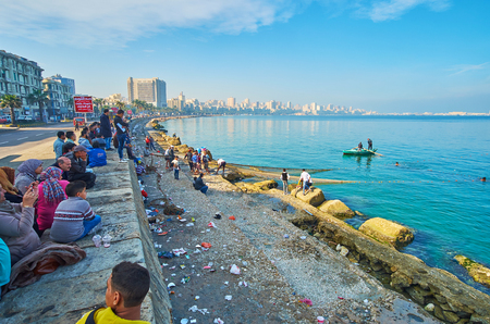ALEXANDRIA, EGYPT - DECEMBER 17, 2017: The fishermen crew gathered a crowd of onlookers in Corniche promenade in the city center, on December 17 in Alexandria. Editorial