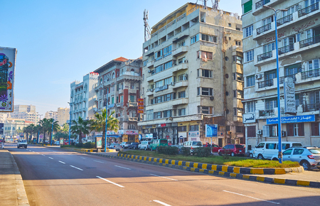 ALEXANDRIA, EGYPT - DECEMBER 17, 2017: The Corniche avenue is the central street of the city, stretching along the coast of Mediterranean sea and containing large amount of historic edifices, on December 17 in Alexandria.