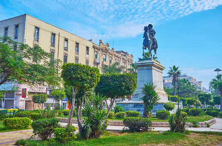 ALEXANDRIA, EGYPT - DECEMBER 17, 2017: The equestrian statue of Muhammad Ali Pasha among the trimmed bushes in garden of El-Tahrir square, on December 17 in Alexandria.