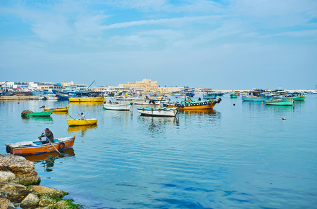 ALEXANDRIA, EGYPT - DECEMBER 17, 2017:  The Eastern harbor is historic place, located next to Qaitbay citadel and nowadays occupied with numerous fishing boats, on December 17 in Alexandria.
