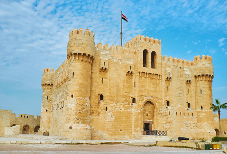 The castle of Qaitbay is surrounded by huge stone ramparts, its the perfect example of medieval defensive stronghold, Alexandria, Egypt.