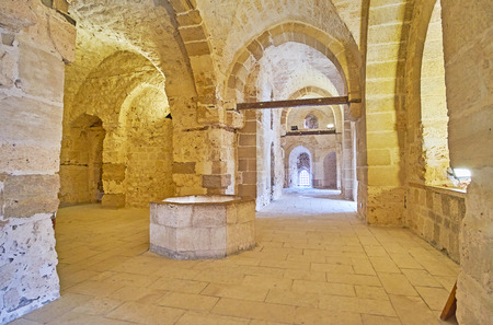 ALEXANDRIA, EGYPT - DECEMBER 17, 2017:  The walk along the narrow corridors of Qaitbay Castle with tall stone vaults and multiple chambers, on December 17 in Alexandria. Editorial