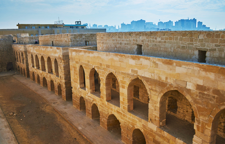 The view on quarters of Qaitbay Fort with preserved medieval walls, Alexandria, Egypt.