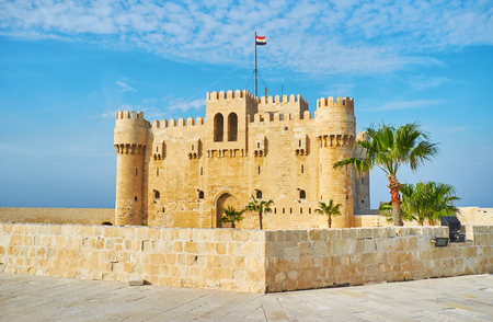 The view on Qaitbay castle from the tall defensive wall of fort, Alexandria, Egypt. Editorial