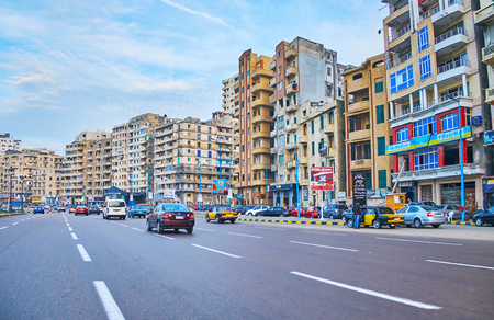 ALEXANDRIA, EGYPT - DECEMBER 17, 2017: Riding on El-Gaish road, stretching along the coast, here locate residential districts, numerous cafes and stores, on December 17 in Alexandria.