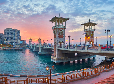 The picturesque sunset in city - Stanley coastal neighborhood is best place to enjoy the evening and walk along the Stanley bridge, built over the sea, Alexandria, Egypt.