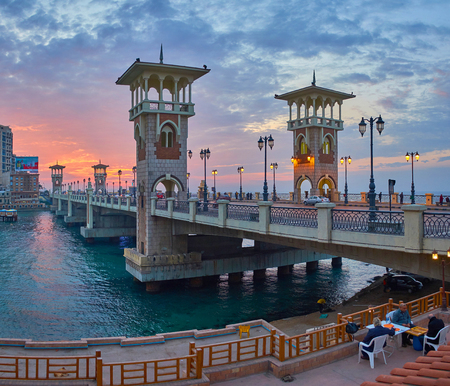 ALEXANDRIA, EGYPT - DECEMBER 17, 2017: The open air terrace at the Stanley bridge is the perfect place to relax and enjoy the sunset, on December 17 in Alexandria.