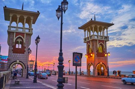 ALEXANDRIA, EGYPT - DECEMBER 17, 2017: The pleasant walk along the busy Stanley bridge, enjoying picturesque sunset sky, on December 17 in Alexandria.
