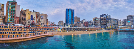 ALEXANDRIA, EGYPT - DECEMBER 17, 2017: Panorama of the Stanley beach with residential high-rises, shopping malls, restaurants and hotels on background, on December 17 in Alexandria. Editorial