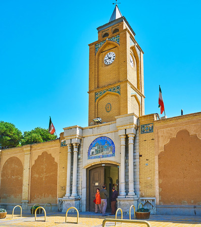 ISFAHAN, IRAN - OCTOBER 20,2017: The entrance gate and clock tower of Armenian Apostolic Holy Savior Cathedral (Surb Amenaprkich Vank), located n Julfa neighborhood, on October 20 in Isfahan.