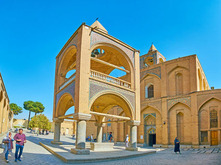 ISFAHAN, IRAN - OCTOBER 20,2017: The courtyard of Holy Savior Cathedral with a view on scenic bell tower and Churchs facade, on October 20 in Isfahan. Editorial