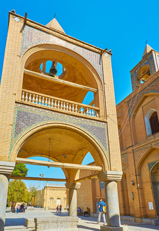ISFAHAN, IRAN - OCTOBER 20,2017: The scenic bell tower of Holy Savior Cathedral constructed with pavilion on its ground level, this area is occupied with medieval stone sarcofagi, on October 20 in Isfahan. Editorial