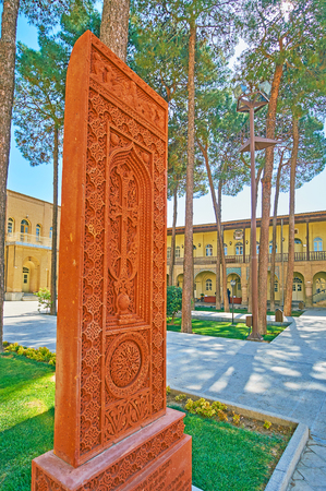 The fine carved pattern decorates traditional Armenian cross-stone, named khachkar and located in Holy Savior Cathedrals garden, Isfahan, Iran.