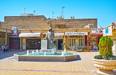 ISFAHAN, IRAN - OCTOBER 20,2017: The stores in Vank alley with the beautiful fountain and statue of Archbishop Khachatur Kesaratsi in Julfa neighborhood,  on October 20 in Isfahan. Editöryel
