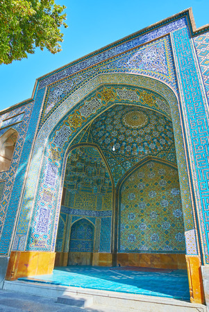 The iwan (portal) of Chaharbagh madraseh is covered with picturesque Islamic patterns in blue gamma, Isfahan, Iran. Stock Photo