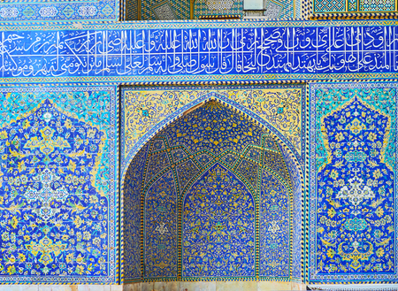 The facade of the mosque in Chaharbagh madraseh is decorated with scenic niches and panels, covered with fine Islamic patterns of tiles, Isfahan, Iran. Stock Photo