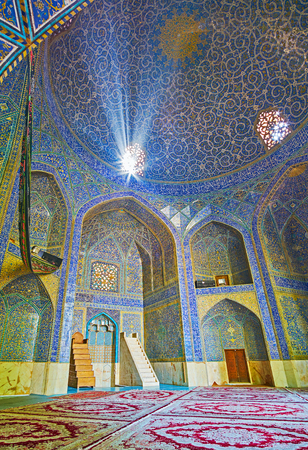 ISFAHAN, IRAN - OCTOBER 20, 2017: Interior of mosque of Chaharbagh madraseh, walls and dome decorated with beautiful ornaments of glazed tiles, on October 20 in Isfahan. Editorial