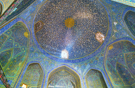 ISFAHAN, IRAN - OCTOBER 20, 2017: The cupola of the mosque in Chaharbagh Theological school boasts unique tiled traceries and fine Arabic calligraphy, on October 20 in Isfahan.