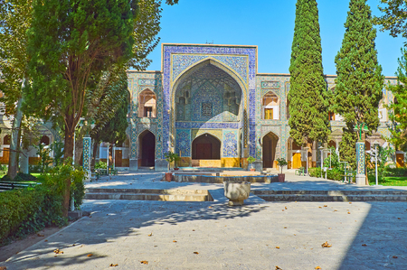 The medieval Chaharbagh madraseh is also famous as Four Gardens madraseh and nowadays it boasts lovely shady garden with benches and fountains, Isfahan, Iran.