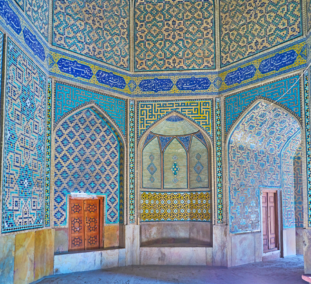 ISFAHAN, IRAN - OCTOBER 20, 2017: The scenic interior of Chaharbagh madraseh with rich tiled decors, arched niches and calligraphic inscriptions, on October 20 in Isfahan.