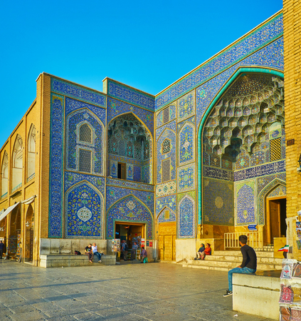 ISFAHAN, IRAN - OCTOBER 20, 2017: The scenic tiled patterns of the main portal of Sheikh Lotfollah mosque, located in Naqsh-e Jahan square, on October 20 in Isfahan.